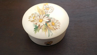 Round Trinket Box By Purbeck Pottery Showing A Daisy Like Flower And Wheat