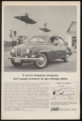 1964 Saab coupe car at gas station photo vintage print ad