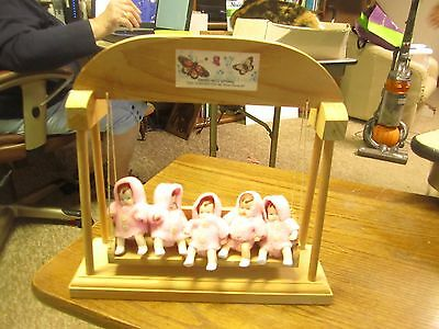 Dionne Quintuplets, 5 babies on swing, Cute pink outfits