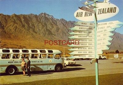 SIGN POST, QUEENSTOWN, N.Z. AIRPORT - Mt. Cook & Southern Lakes Tour Co. bus