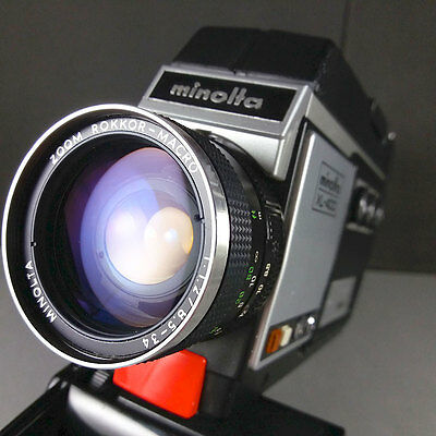 Minolta XL-400 Super 8 Camera w/Rokkor 8.5-34mm f/1.2 Lens Grip & Lens cap