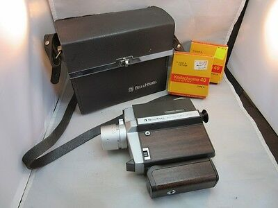 Vtg Bell & Howell 8mm home movie camera w/2 rolls of film &case. Autoload 308