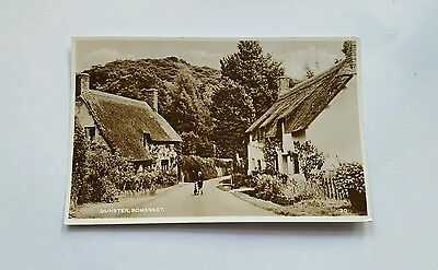 dunster somerset  postcard cottages and young boy with cycle real photo unposted