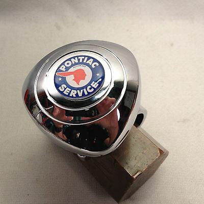 NEW PONTIAC   STEERING WHEEL SPINNER KNOB   only FITS NEW VEHICLES round WHEELS