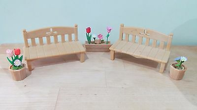 Two Garden Benches And Flower Pots