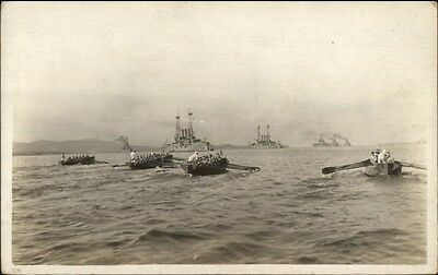 Navy Sailors in Rowboats Rowing Ashore From Battleships WHERE? C1910 RPPC