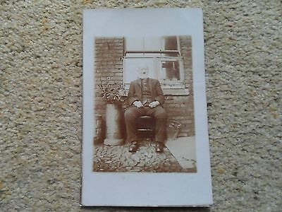 Vintage.r.p. Postcard.of A Old Man Sat Outside House. Anonymous. Not Posted.