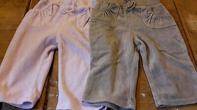 2 pairs girls fleecy trousers 6-9 months George