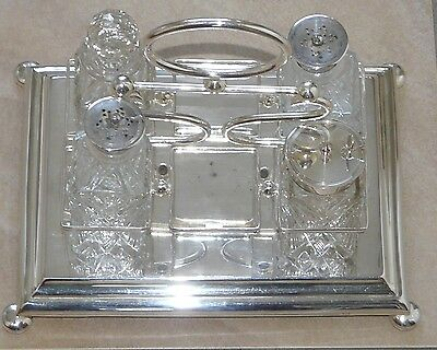 Early 20th Century Silver Plated 6 Station Cruet With 4 cut Glass Bottles