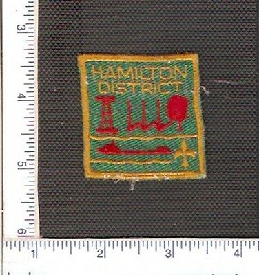 a Vintage used Scouts Canada shoulder patch from the Hamilton District.