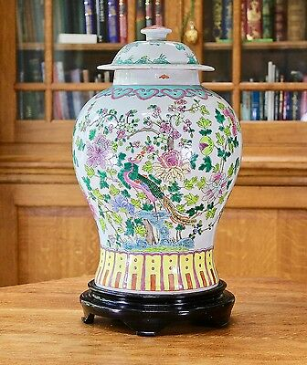 Large chinese hand decorated temple jar on wooden stand