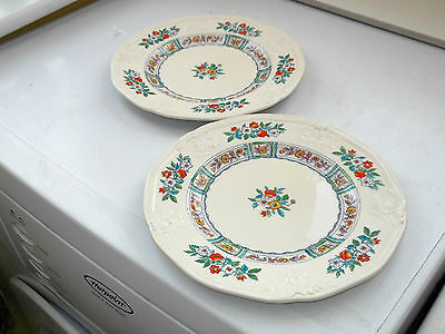TWO 1930s MINTON SALAD PLATES IN PALE CREAM WITH A  FLORAL PATTERN
