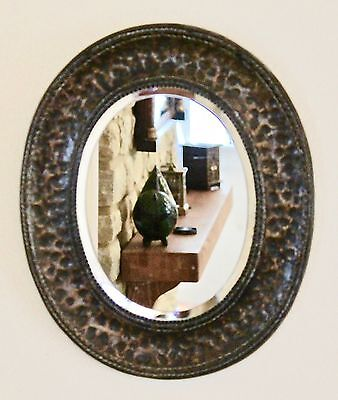 Arts & Crafts hand beaten copper oval wall mirror Bevelled glass