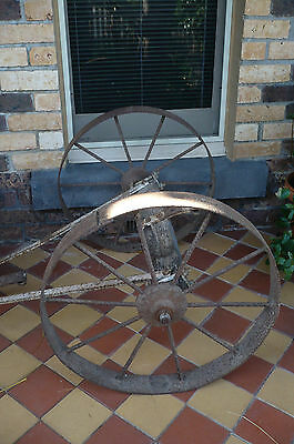 Cast Iron Wagon Wheels. A Pair. Still attached to orig. axle etc.