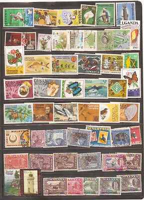 a stock page of mixed used stamps from British Colonies, starting with Jamaica.