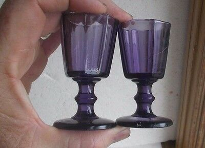 PAIR OF ANTIQUE AMETHYST 1870s FOOTED 8 SIDED WINE TASTERS OR SHOT GLASSES