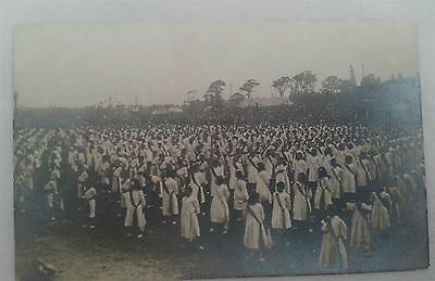 Early Real Photographic postcard Large group wearing robes