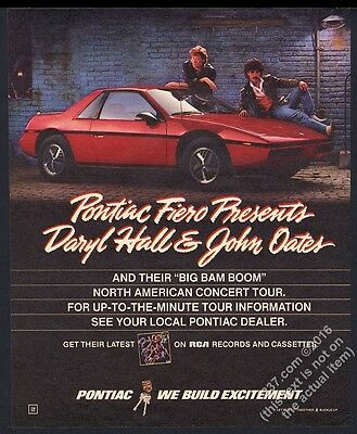 1987 Hall and Oates photo Pontiac Fireo red car vintage print ad
