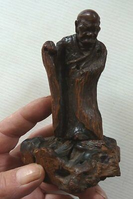 An Old Oriental Carved Wooden Man On Root Carved Base