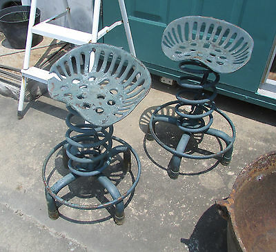 "Antique Vintage.. Two (2) Cast Iron Tractor Seat Stools 23"" High .. Local Pickup"