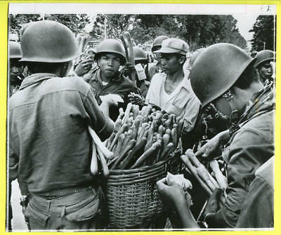 1970 Cambodian Officer Distributes Bread & Money to Soldiers Rokakong Wirephoto