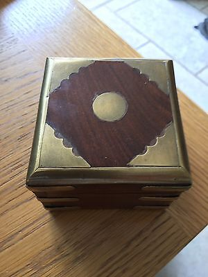 Collectable vintage wooden trinket box with metal decoration.