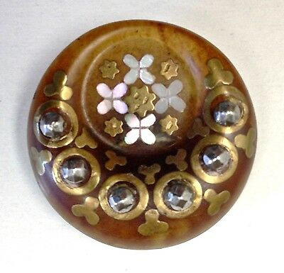 Medium horn button, molded into a crescent with inlaid pearl, brass and steels