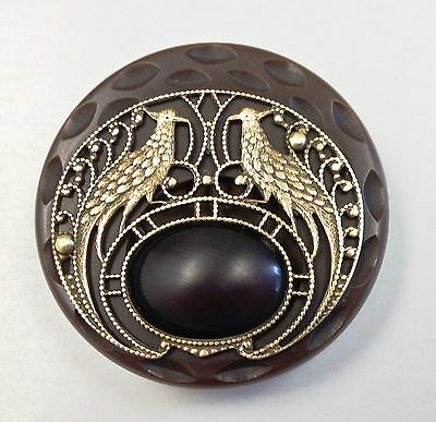 Large bakelite button with 2 exotic brass filigree birds. Mint!