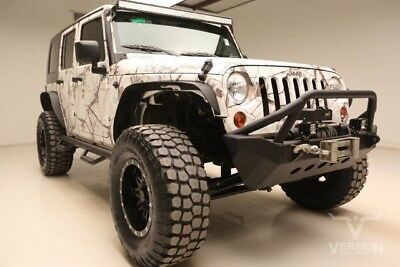 2010 Jeep Wrangler Unlimited Sahara Sport Utility 4-Door 2010 Navigation Gray Cloth Hard Top V6 SMPI Auxiliary We Finance 66k Miles