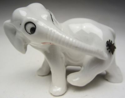 """Antique German Porcelain Elephant Looking At Metal Fly on His Rear End 3 ¼"""" long"""