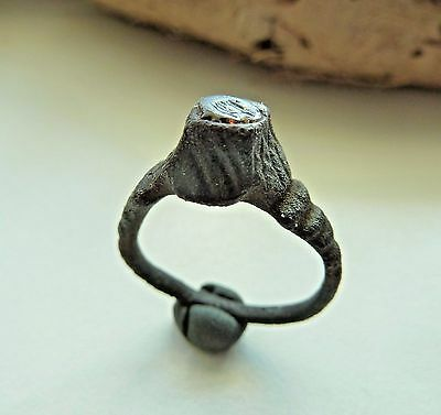 Medieval bronze ring with glass insert (424).