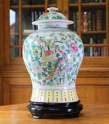Substantial large chinese hand decorated temple jar on wooden stand