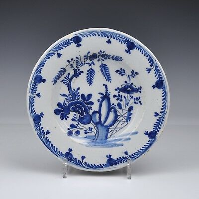 "A Delft Blue And White 18th Century Plate With ""Flower Garden"""