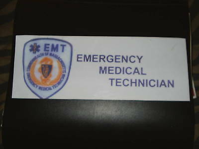 "Massachusetts EMT dashboard placard. 11""x4"" laminated photo."