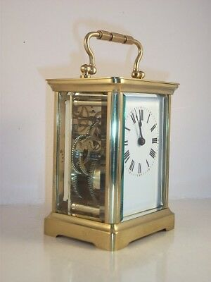 Classic antique brass carriage clock & key. Fully serviced in September 2017.