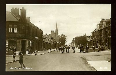 BATHGATE Scotland Mid Street with people and corner shop RP