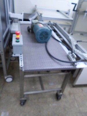 "18"" x 48"" PLASTIC HINGED CONVEYOR ON STAINLESS STEEL WHEELED FRAME"