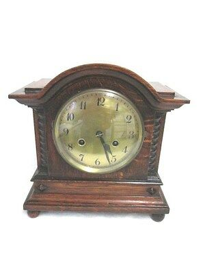A Junghans Early 20th Century Dark Solid Oak Chiming Mantel Clock
