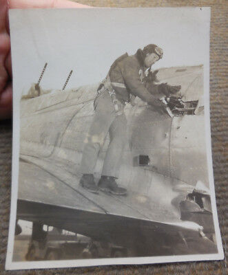 Vintage WW II B-17 Officer Checking Flak Damage B/W Photograph Named Lt Wilson