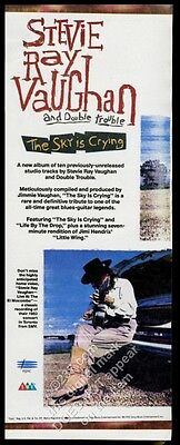 1991 Stevie Ray Vaughan photo The Sky is Crying album release vintage print ad