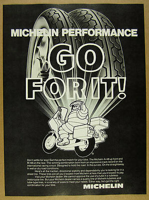 1983 Michelin Tires michelin man riding motorcycle art vintage print Ad