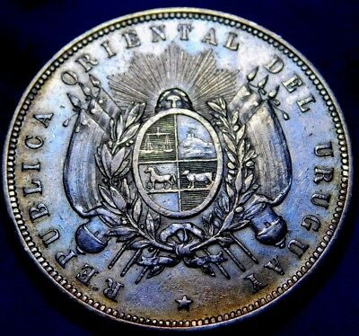 1877 Uruguay One Peso  Beunos Aires Mint  A22-940