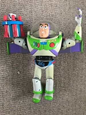 "Disney Store Official 14"" talking Toy Story Buzz Lightyear superhero doll figure"
