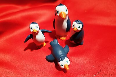 bundle of 4 penguins 1 adult 3 small black orange and white varied poses
