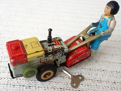 Vintage CHINA MS 857 Tractor with Girl clockwork wind-up tin toy