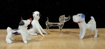 Four Miniature Glass Dogs