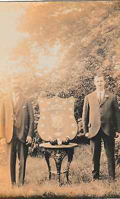 2 unknown gents standing with large bowls/bowling trophy/shield - old post card