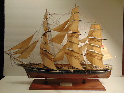 Older Cutty Sark tall mast ship model on wooden base
