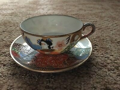 Vintage hand painted Japanese eggshell cup and saucer