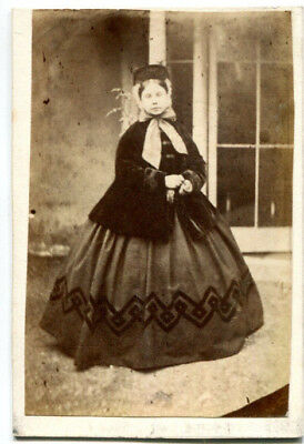1880s cdv portrait of a woman in a full dress by an unknown studio